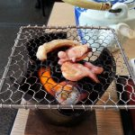 Grilling octopus.